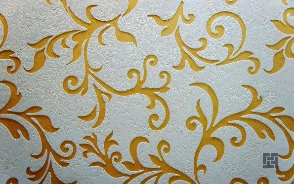использование трафарета для создания оригинального узора на стене