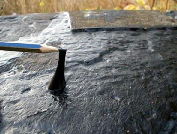 Обмазка поверхности фундамента