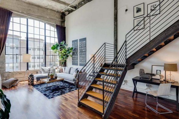 Гостиная в стиле минимализм с лестницей на второй этаж