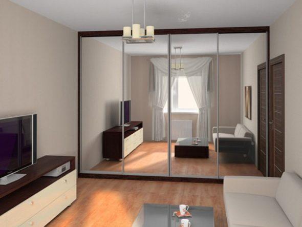 Фото: зеркальный шкаф в малогабаритной гостиной