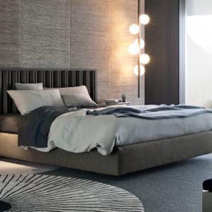 Спальня в серых тонах с круглым ковром