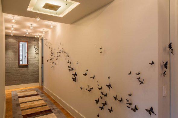 Стену можно оформить объёмными изображениями бабочек