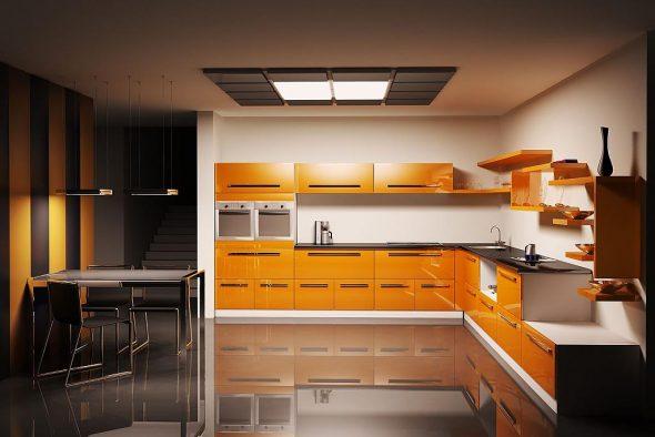 Просторная кухня в оранжевом оформлении